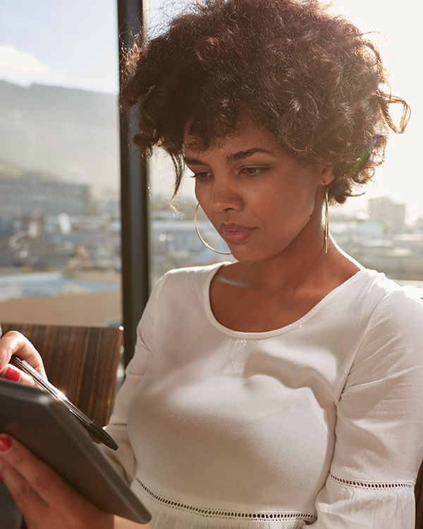 Black woman working on a tablet